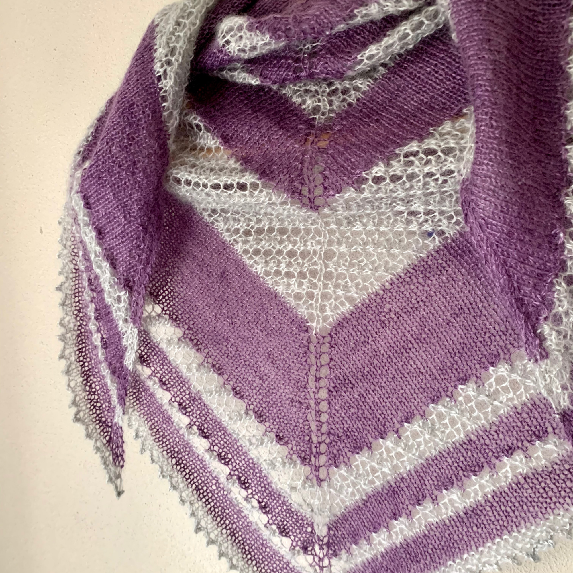 Shooting Stars. Close up of shawl. The shawl is wrapped around to reflect the edge drapping over the shoulder.